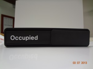 Black Sign with Square Corners and White Lettering Image
